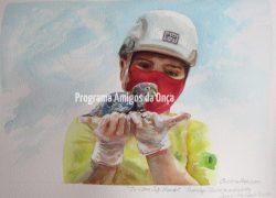 """In Ultra Safe Hands, Damilys Oliveira and Baby Spix's Macaw"" , por Christina Hopkinson"